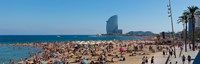 Tourists on the beach with W Barcelona hotel in the background, Barceloneta Beach, Barcelona, Catalonia, Spain Fine Art Print