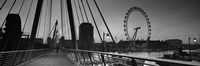 Bridge across a river with a ferris wheel, Golden Jubilee Bridge, Thames River, Millennium Wheel, London, England by Panoramic Images - various sizes