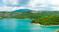 Lake with mountain in the background, Lake of Sainte-Croix, Var, Provence-Alpes-Cote d'Azur, France by Panoramic Images - various sizes