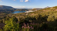 High angle view of a town in distant, Zahara De La Sierra, Cadiz Province, Andalusia, Spain by Panoramic Images - various sizes