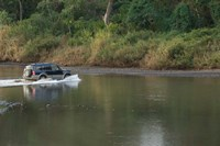 Sports utility vehicle crossing a river, Ora River, Playa Carrillo, Guanacaste, Costa Rica Fine Art Print