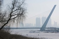 Songhuajiang Highway Bridge over the frozen Songhua River with buildings in the background, Harbin, Heilungkiang Province, China by Panoramic Images - various sizes
