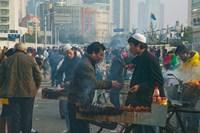 Muslim Chinese Uyghur minority food vendors selling food in a street market, Pudong, Shanghai, China Fine Art Print