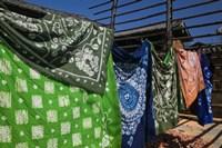 Batik fabric souvenirs at a market stall, Baisha, Lijiang, Yunnan Province, China Fine Art Print