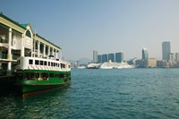 Star ferry on a pier with buildings in the background, Central District, Hong Kong Island, Hong Kong Fine Art Print