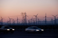 Cars moving on road with wind turbines in background at dusk, Palm Springs, Riverside County, California, USA Fine Art Print