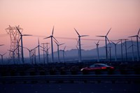 Car moving on a road with wind turbines in background at dusk, Palm Springs, Riverside County, California, USA Fine Art Print