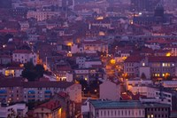Aerial view of building lit up at dusk viewed from Parc de Montjuzet, Clermont-Ferrand, Auvergne, Puy-de-Dome, France by Panoramic Images - various sizes