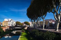 Buildings along the Basse Riverfront, Perpignan, Pyrenees-Orientales, Languedoc-Roussillon, France by Panoramic Images - various sizes