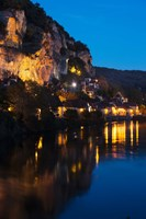 Buildings lit up at evening, Dordogne River, La Roque-Gageac, Dordogne, Aquitaine, France by Panoramic Images - various sizes