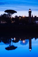 Silhouette of Old Port Lighthouse at dawn, La Rochelle, Charente-Maritime, Poitou-Charentes, France by Panoramic Images - various sizes