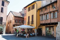 People at sidewalk cafe, Piazza San Fedele, Como, Lombardy, Italy by Panoramic Images - various sizes - $54.99