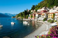 Houses at waterfront with boats on Lake Como, Varenna, Lombardy, Italy Framed Print