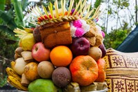 Basket of fruits and bakery items being offered at temple on holy day, Tiga, Susut, Bali, Indonesia by Panoramic Images - various sizes