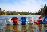 Adirondack chairs partially submerged in the Lake Muskoka, Ontario, Canada by Panoramic Images - various sizes