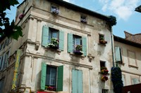 View of an old building with flower pots on each window, Rue Des Arenes, Arles, Provence-Alpes-Cote d'Azur, France Fine Art Print