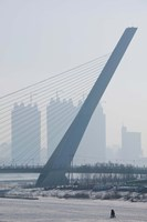 Songhuajiang Highway Bridge across the frozen Songhua River with buildings in the background, Harbin, China by Panoramic Images - various sizes