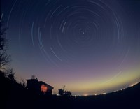 Circumpolar star trails with a faint aurora over horizon, Alberta, Canada Fine Art Print