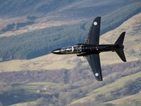 A Hawk T1 trainer aircraft of the Royal Air Force low flying over North Wales Fine Art Print
