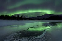Reflected aurora over a frozen Laksa Lake, Nordland, Norway Fine Art Print