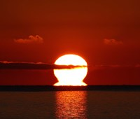 An omega-shaped sunrise above the water in Buenos Aires, Argentina by Luis Argerich - various sizes