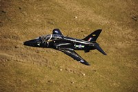 A Hawk T1 trainer aircraft of the Royal Air Force flying over barren terrain North Wales Fine Art Print