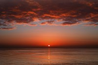 A layer of clouds is lit by the rising sun over Rio de la Plata, Buenos Aires, Argentina by Luis Argerich - various sizes