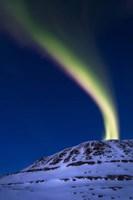 An aurora borealis shooting up from Toviktinden Mountain, Norway Fine Art Print
