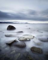 Long exposure scene of rocks in Vaagsfjorden fjord, Norway Fine Art Print