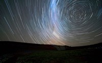 Star trails around the south celestial pole, Somuncura, Argentina Fine Art Print