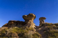Starry sky above hoodoo formations at Dinosaur Provincial Park, Canada by Alan Dyer - various sizes
