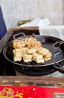 China, Shanghai. Village of Zhujiajiao. Homemade snacks cooked in wok. by Cindy Miller Hopkins - various sizes