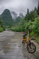 Bicycle sits in front of the Guilin Mountains, Guilin, Yangshuo, China Fine Art Print