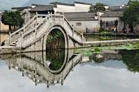 Bridge reflection, Hong Cun Village, Yi County, China by Adam Jones - various sizes