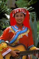 Ethnic Dancer Playing Guitar, Kunming, Yunnan Province, China by Bill Bachmann - various sizes