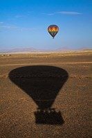 Hot air balloon casting a shadow over Namib Desert, Sesriem, Namibia by David Wall - various sizes