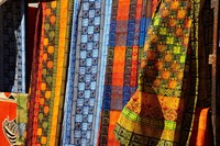 Cloth stall, African curio market, Cape Town, South Africa. Fine Art Print