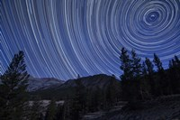 Star trails above mountain peaks near Yosemite National Park, California Fine Art Print