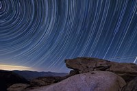 Star trails and a granite rock outcropping overlooking Anza Borrego Desert State Park Fine Art Print
