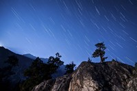 Whisps of moonlight shine through the mountain peaks of Inyo National Forest Fine Art Print