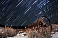 Abandoned farm equipment against a backdrop of star trails Fine Art Print