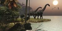 Two Brachiosaurus dinosaurs enjoy a beautiful sunset Framed Print