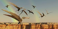 A flock of Pterodactyls fly out of a canyon Fine Art Print