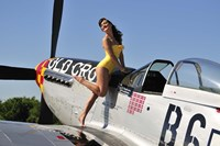 Beautiful 1940's style pin-up girl posing with a P-51 Mustang Fine Art Print