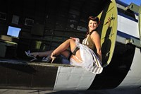 Sexy 1940's style pin-up girl sitting inside of a C-47 Skytrain aircraft Fine Art Print