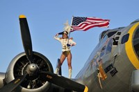 1940's style majorette pin-up girl on a B-17 bomber with an American flag Fine Art Print