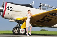 1940's style Navy pin-up girl leaning on the wing of a T-6 Texan Fine Art Print