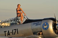 1940's style pin-up girl sitting on the cockpit of a World War II T-6 Texan Fine Art Print