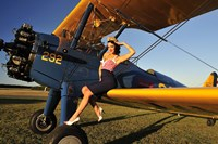 1940's style pin-up girl sitting on the wing of a Stearman biplane Fine Art Print
