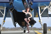 1940's style pin-up girl in cocktail dress posing in front of a TBM Avenger Fine Art Print